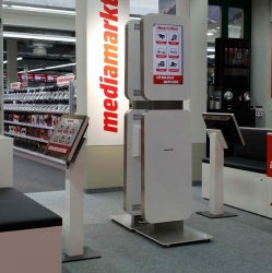 Media Markt in Bern relies on screens of various sizes and terminal stands that...