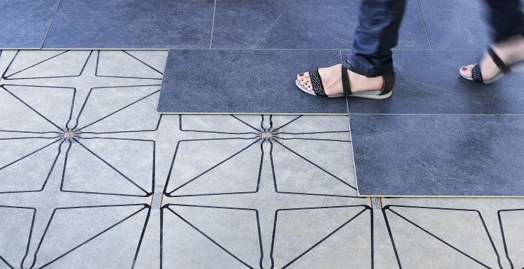 Photo: Woman walking on floor with sensor underlay; copyright: Future-Shape GmbH...
