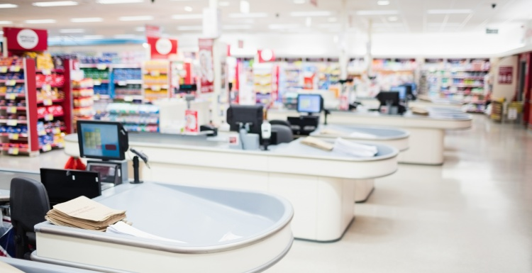Photo: Cash registers and shelves in a supermarket; copyright: panthermedia /...