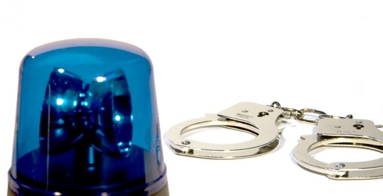 Handcuffs and police light