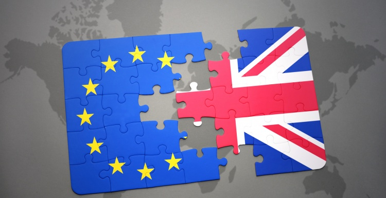 Photo: Flags of UK and EU as separate puzzle pieces; copyright:...