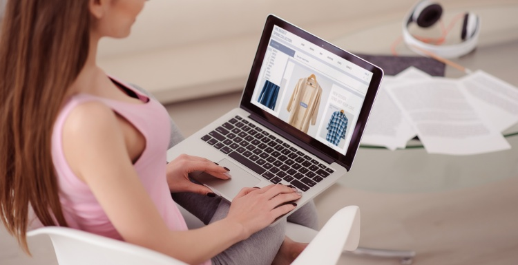 Photo: Woman shopping for fashion online on her laptop; copyright:...