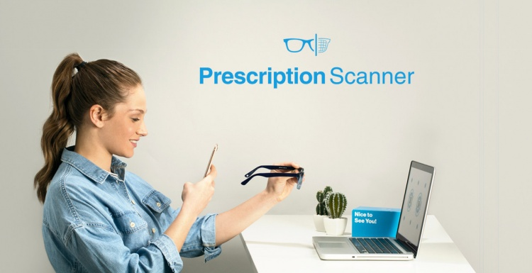 Woman scanning her glasses with a smartphone; copyright: GlassesUSA.com...