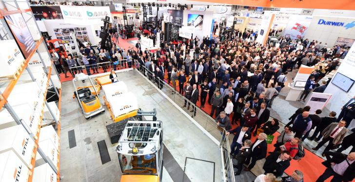 LogiMAT 2019 with visitors and one exhibitor with commercial vehicles;...
