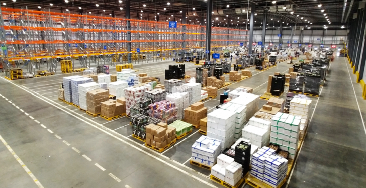 Huge warehouse with pallets and crates; copyright: Walmart...