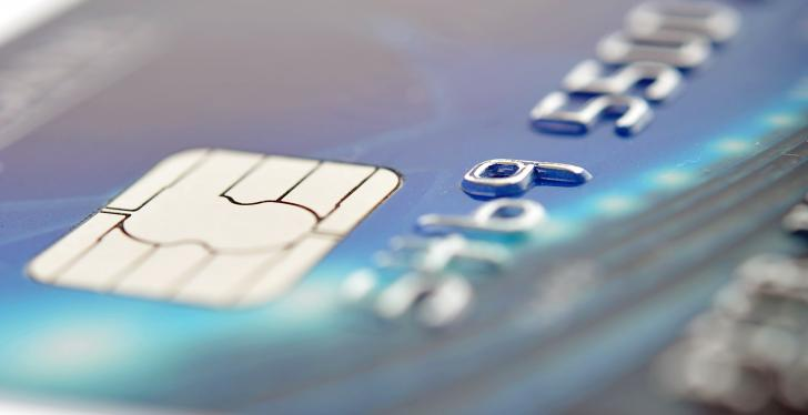 Close-up of a payment card with chip and card number; copyright:...
