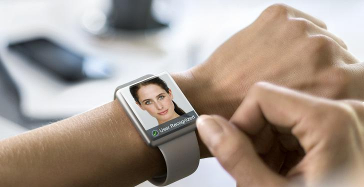 Smart watch on an arm with a human face on the display; copyright: Osram...