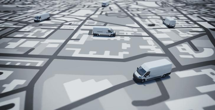 Trucks on a paper map in grey color; copyright: PantherMedia/alphaspirit...