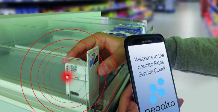 A person holds a smartphone on which the neoalto Retail Service Cloud can be...