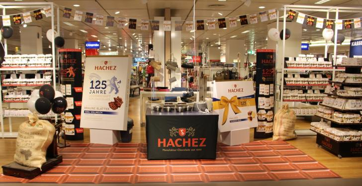 An advertising space for various chocolates in a department store with a floor...