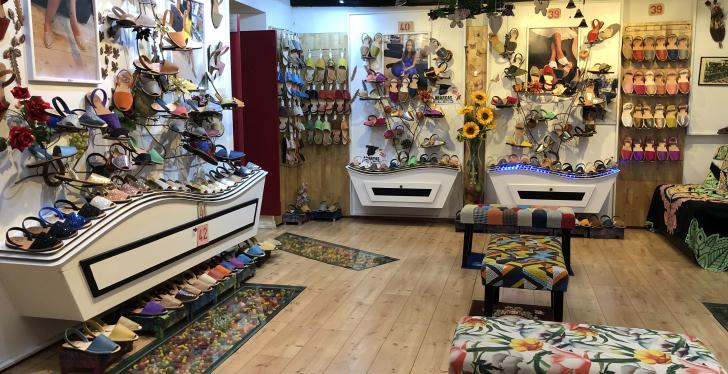 A colourfully decorated shoe shop