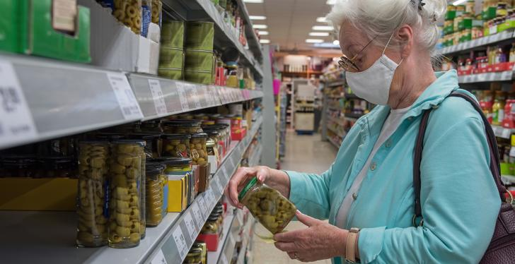 Older woman with face mask in a supermarket