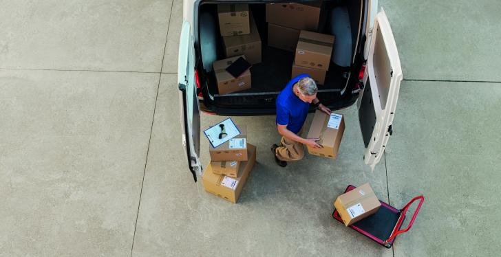 A man unloading a van, getting a birds-eye view