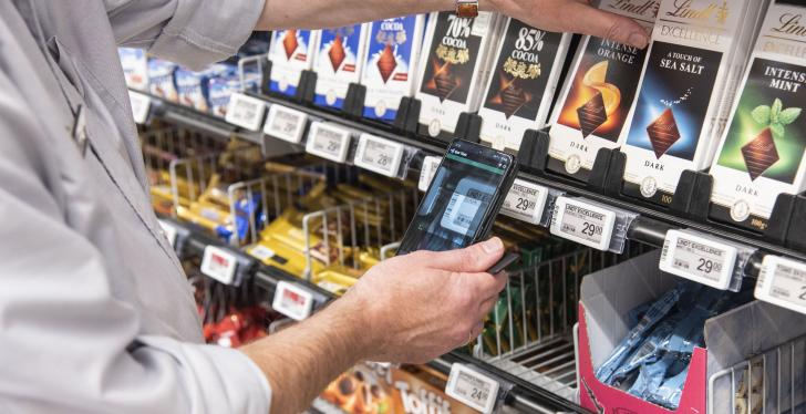 Cell phone scans price tag