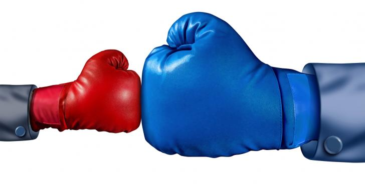 A small red boxing glove against a big blue boxing glove...