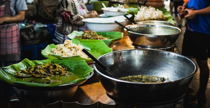 South Asian market with fresh prepared meals on a table...