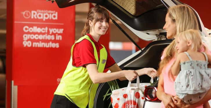 A woman loading shopping bags into another womans car; copyright: Coles Group...