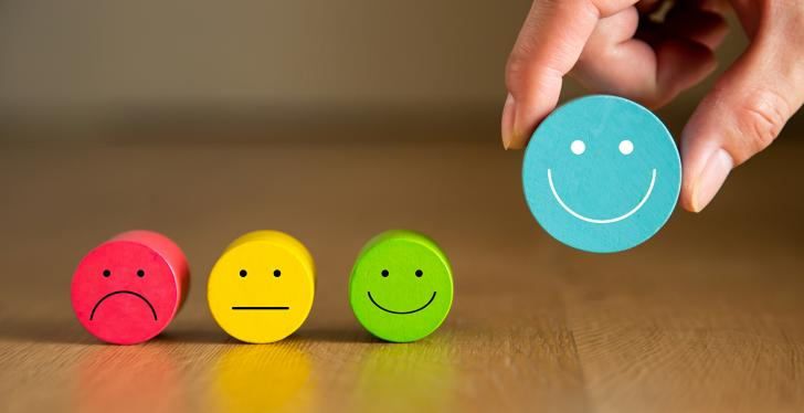 Four colorful smileys, from unhappy to smiling; copyright:...