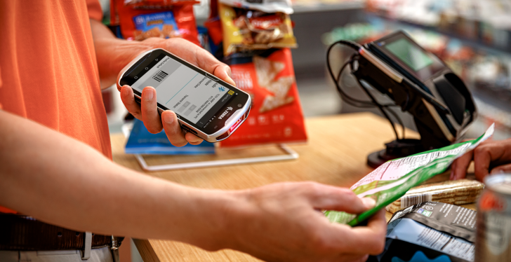 cashier scans product with smart device