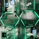 view into a modern black Nike store with green lamps and sports shoes...