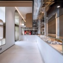 A modern style pastry store with curved arches and large windows...