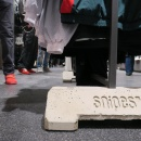 A concrete base for a coat stand with the Snipes logo embedded...