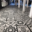 A black and white patterned tile floor