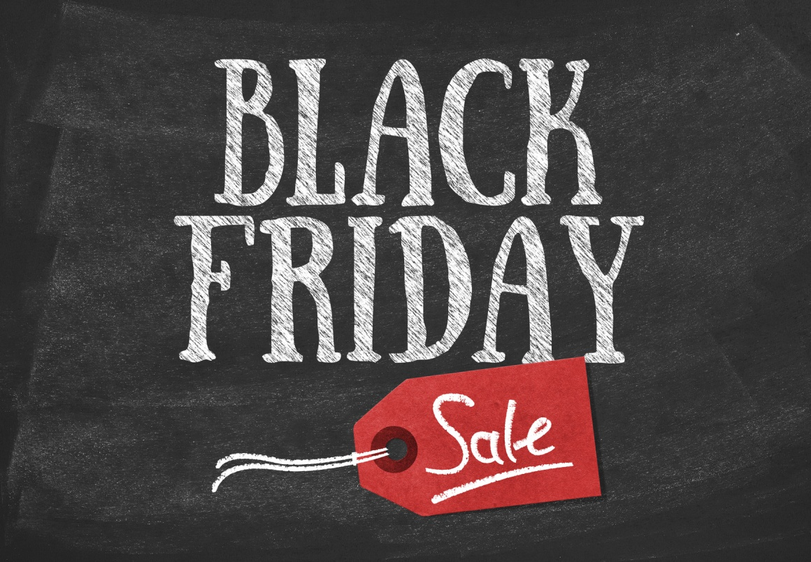 Photo: White Black Friday lettering on black board with red price tag;...