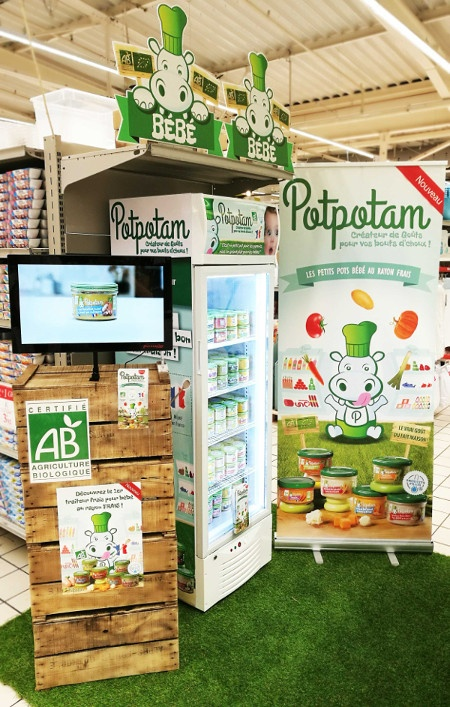 Photo: Digital advertising screen at a stand for childrens food; copyright:...