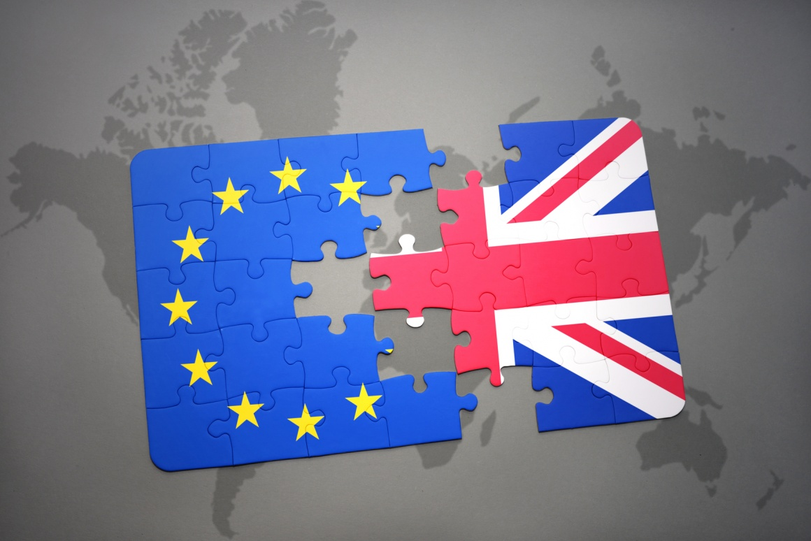 Photo: EU and UK flag made of puzzle pieces separated by gap; copyright:...