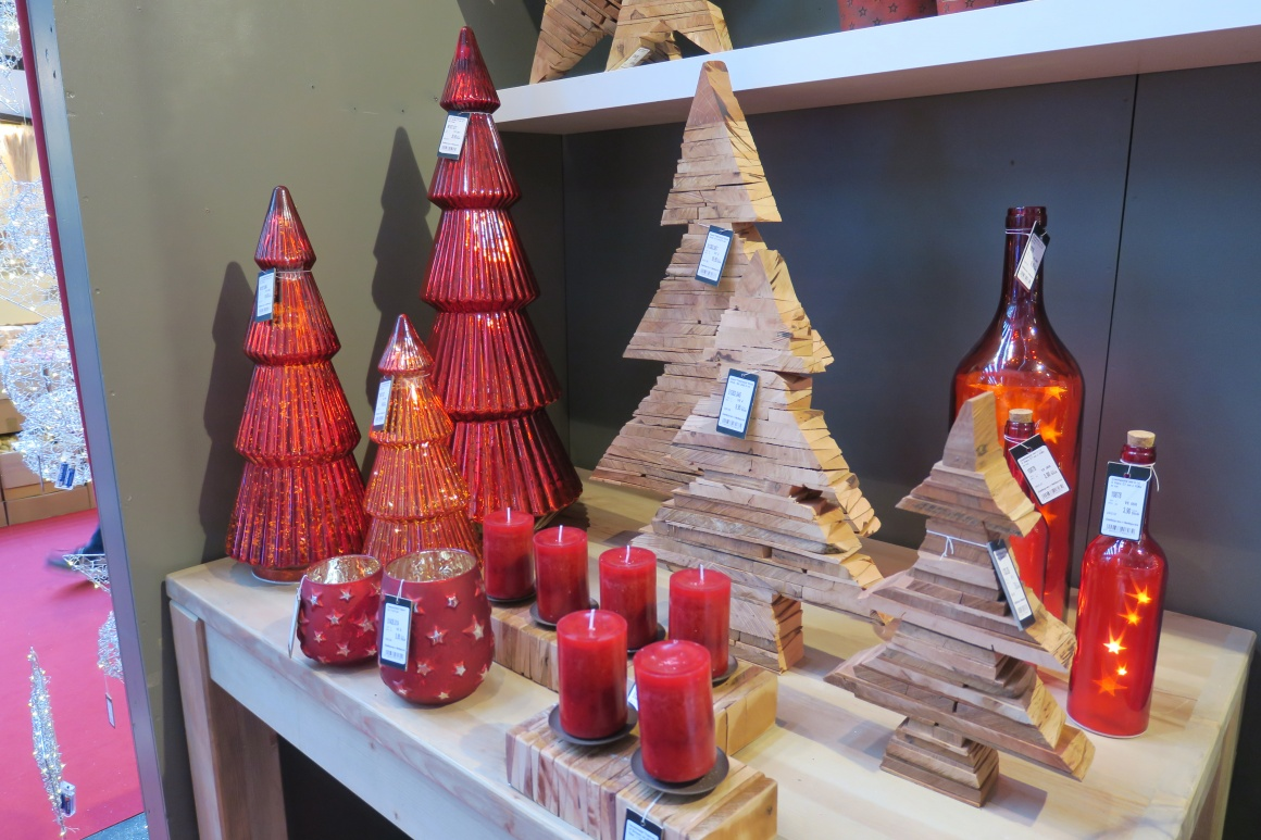 Christmas decorations made of glass and wood in the form of fir trees;...
