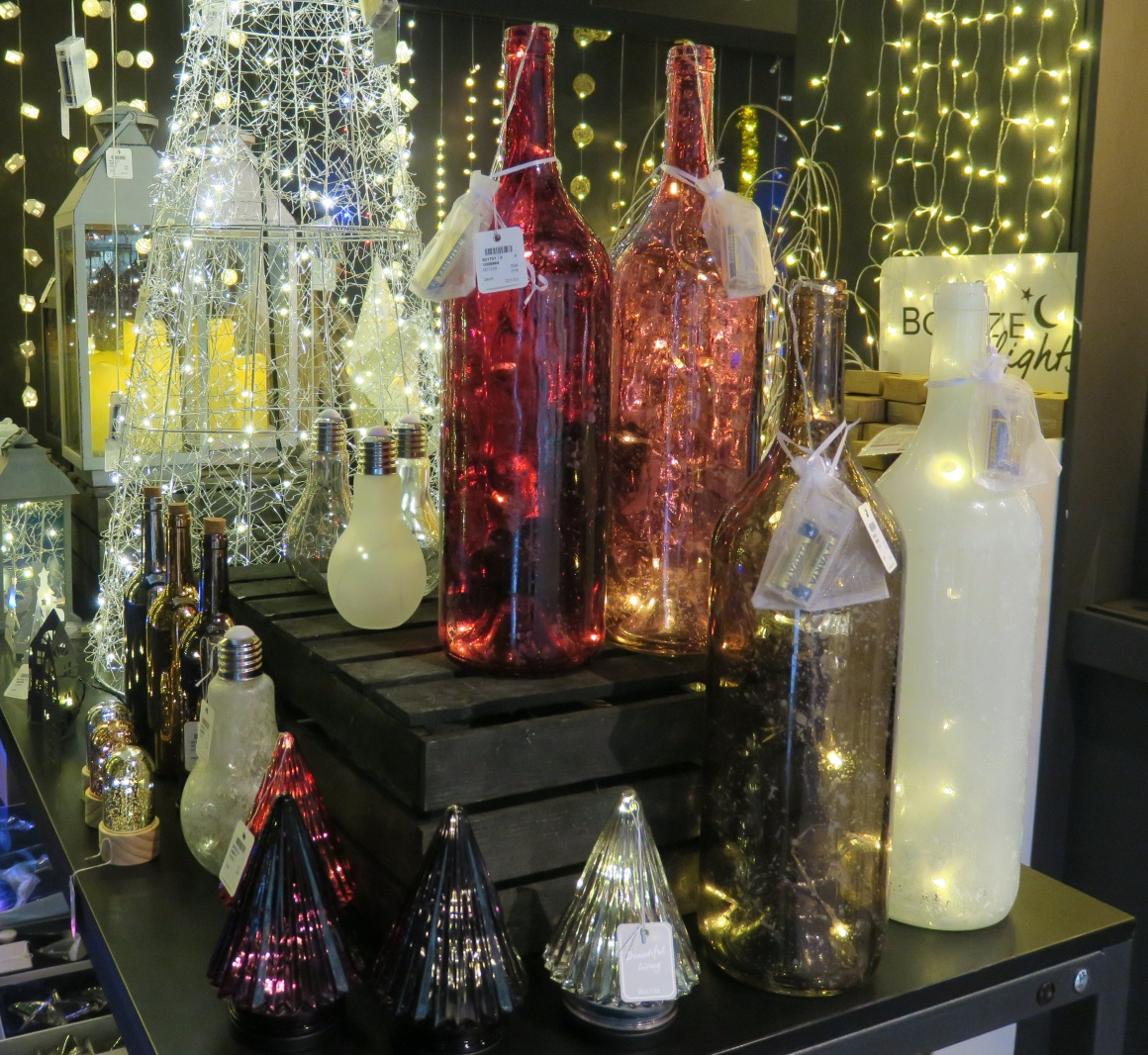 Bottles and vases with glowing lights inside; copyright: iXtenso / Pott...