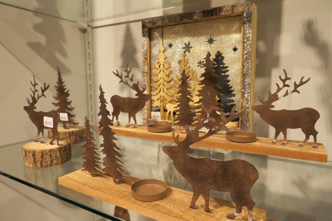 Christmas decoration elements made of wood and artificially rusted metal;...