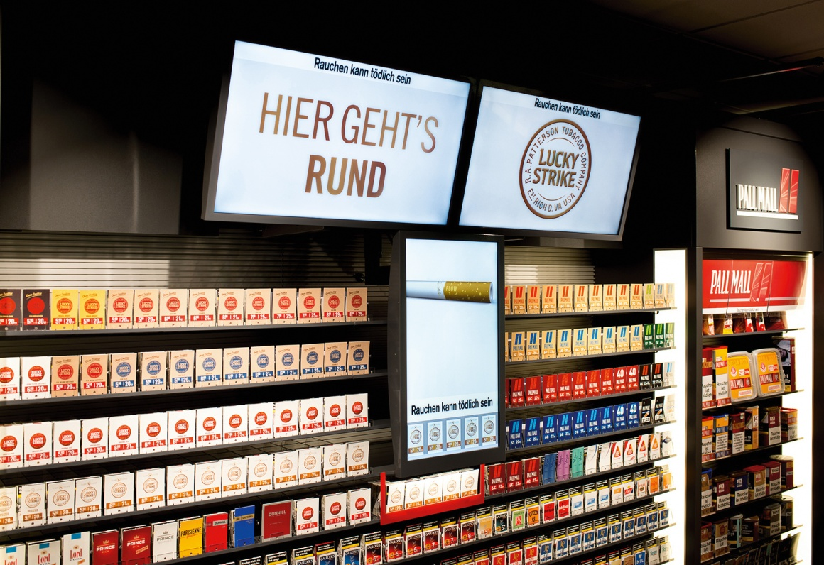 Digital Signage at a tobacco shelf; copyright: Westiform...