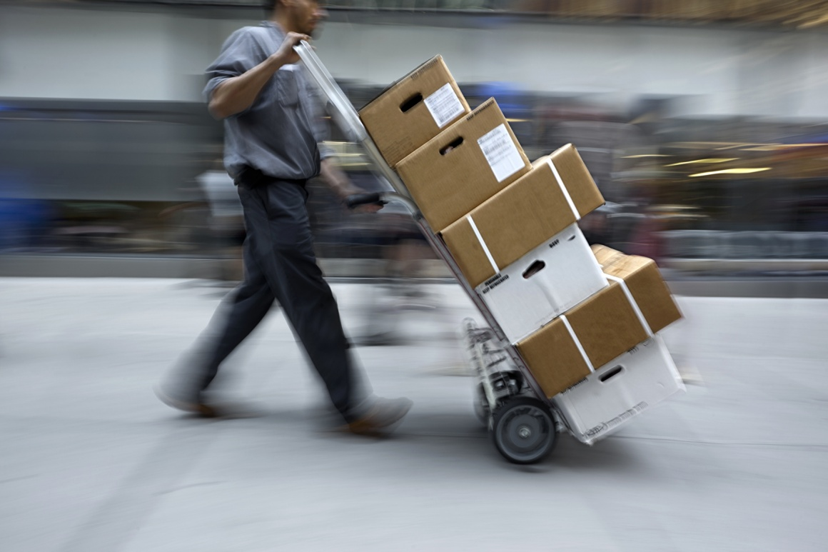 Deliverer transports several packages