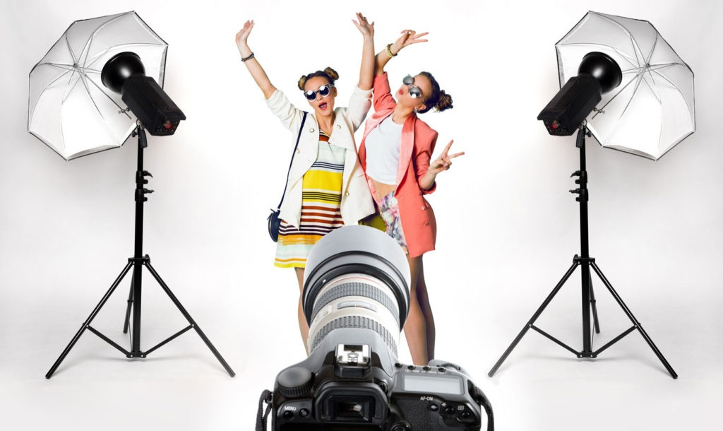 Two women in a photo studio in front of the camera....
