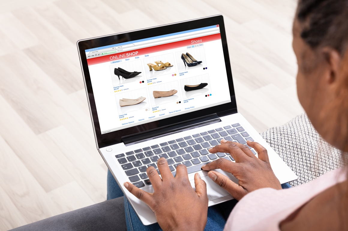 Woman shopping online on her laptop