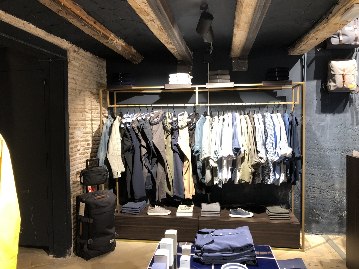 Presentation of clothing at the back of the store.