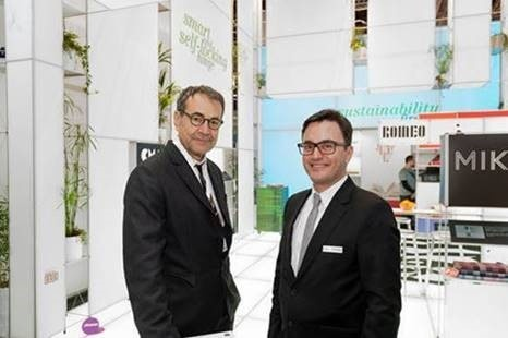 Two men at the booth of burkhardt leitner