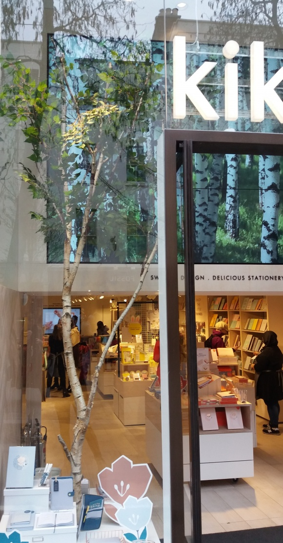 At kikki.K, a large birch tree (real trunk, artificial foliage) takes up the...