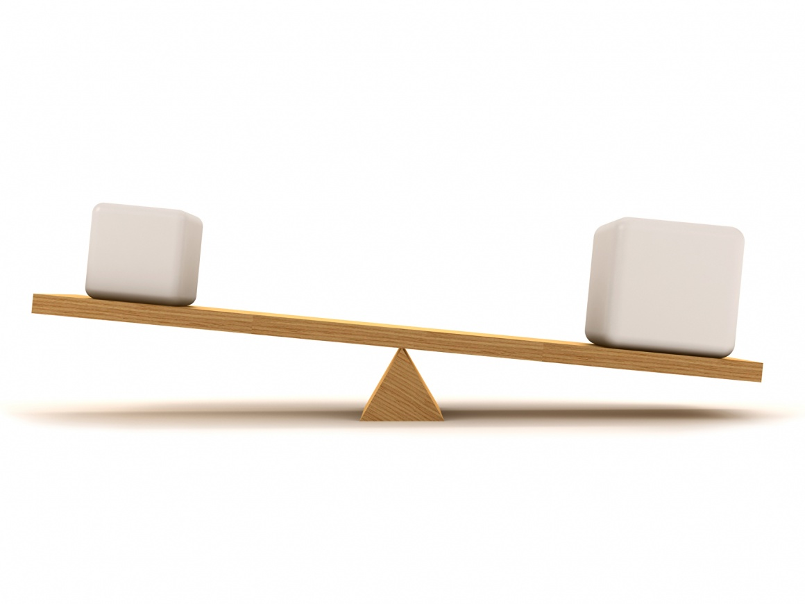A simple wooden seesaw in imbalance with white packets on it...