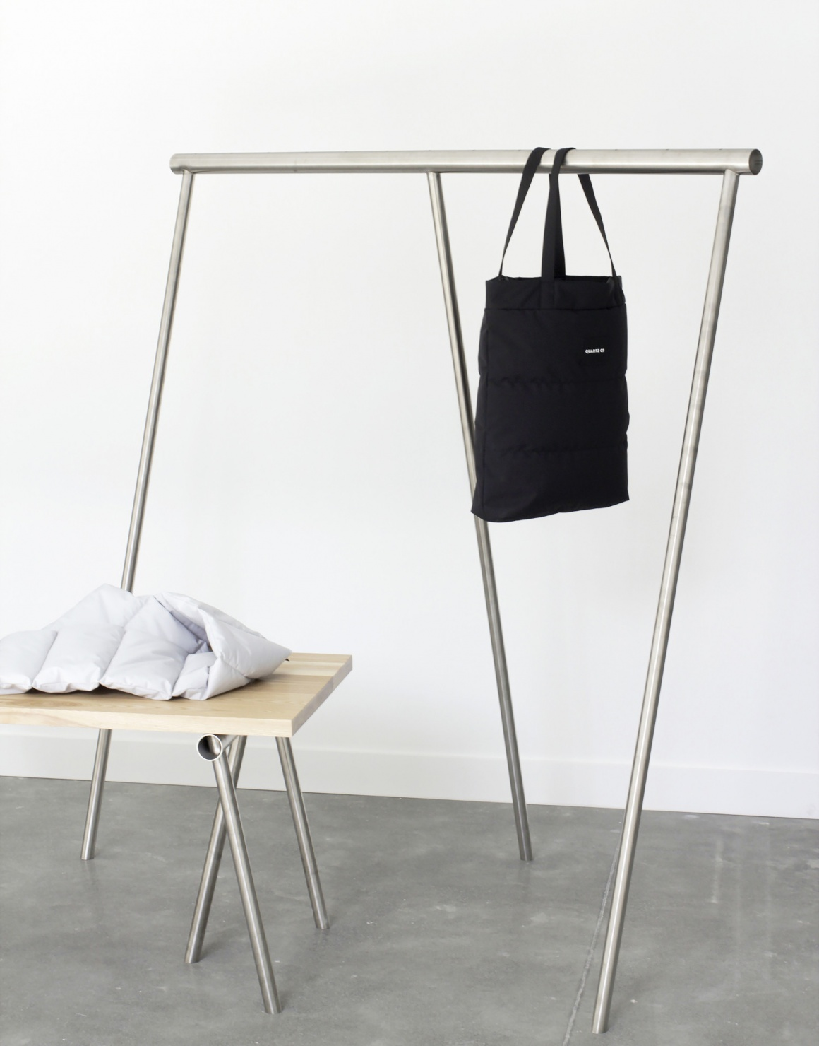 Modern, very simple shelf and table in a fashion showroom...