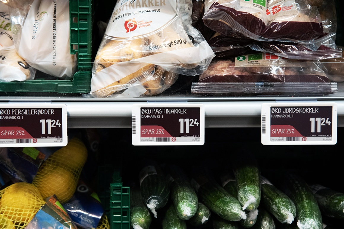 Shows a store shelf full of fresh produce and an electronic shelf label...